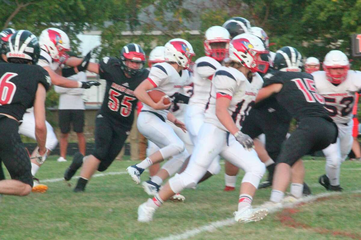 Reed City's Teddy Cross (55) goes after the ball carrier in action earlier this season. (Pioneer file photo)