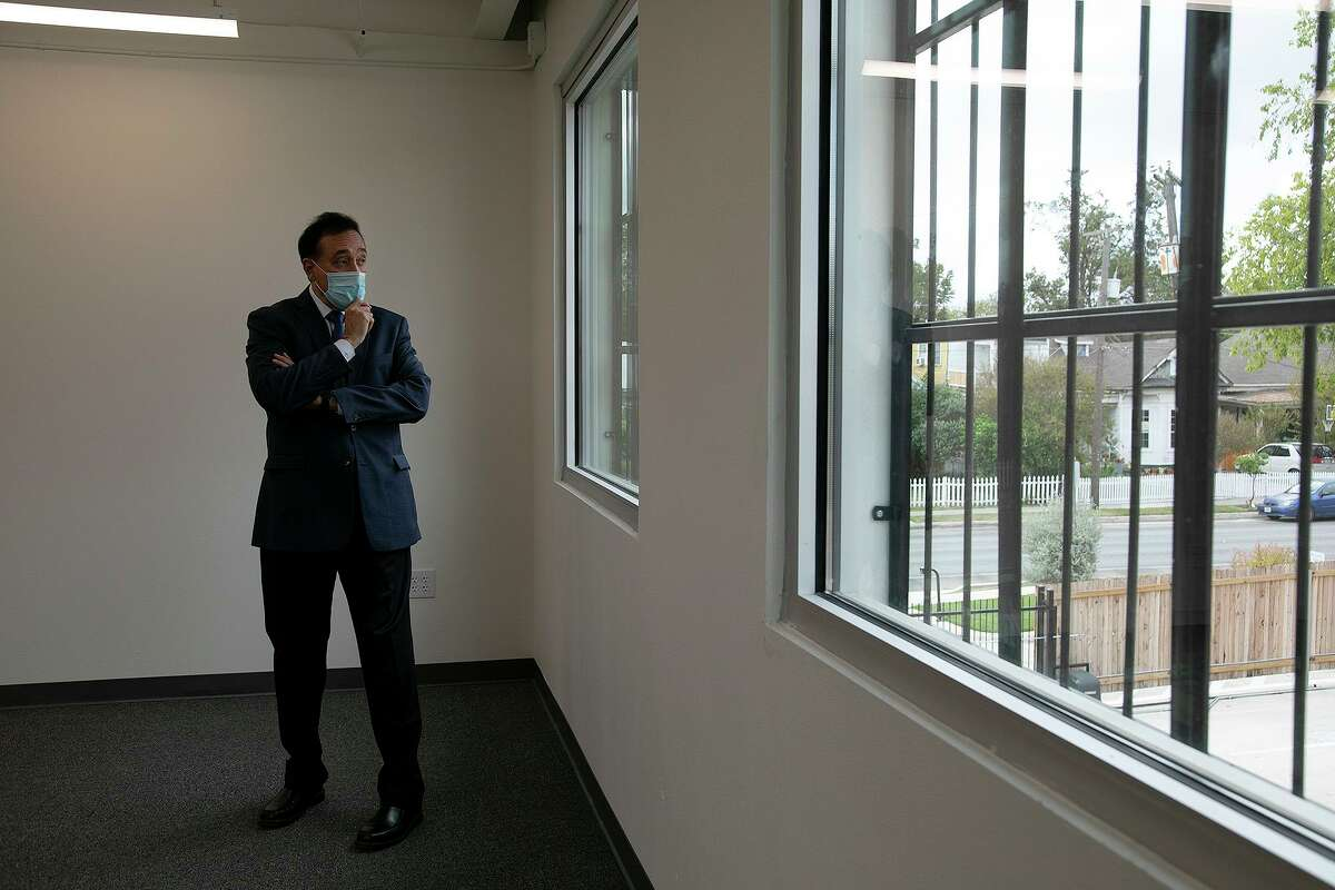 Henry Cisneros walks around a building that once housed his grandfather's print shop. He had been renovating it for co-working spaces but now plans to move his investment firm into it.