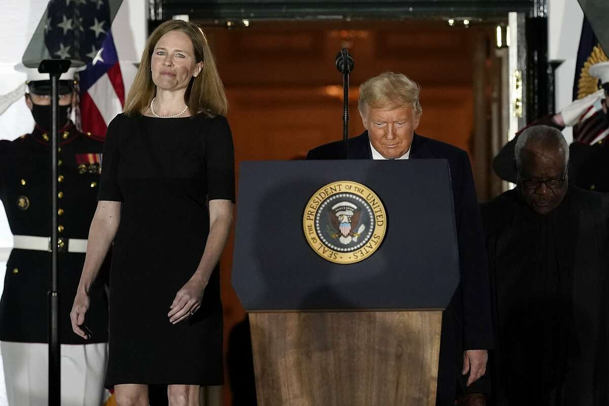 President Donald Trump and Amy Coney Barrett arrive on the South Lawn of the White House White House in Washington, D.C., after Barrett was confirmed to be a Supreme Court justice by the Senate earlier in the evening.