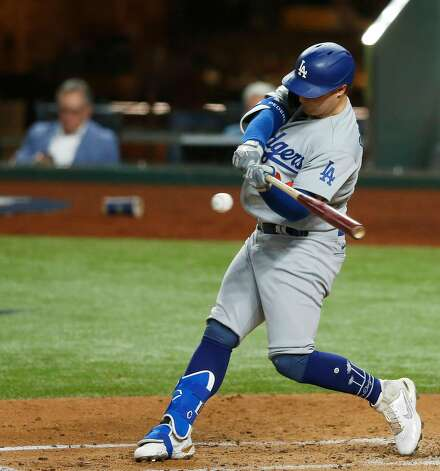 The Los Angeles Dodgers' Joc Pederson hits a solo home against the Tampa Bay Rays during the second inning in Game 5 of the World Series at Globe Life Field in Arlington, Texas, on Sunday, Oct. 25, 2020. (Vernon Bryant/Dallas Morning News/TNS) Photo: Vernon Bryant / TNS