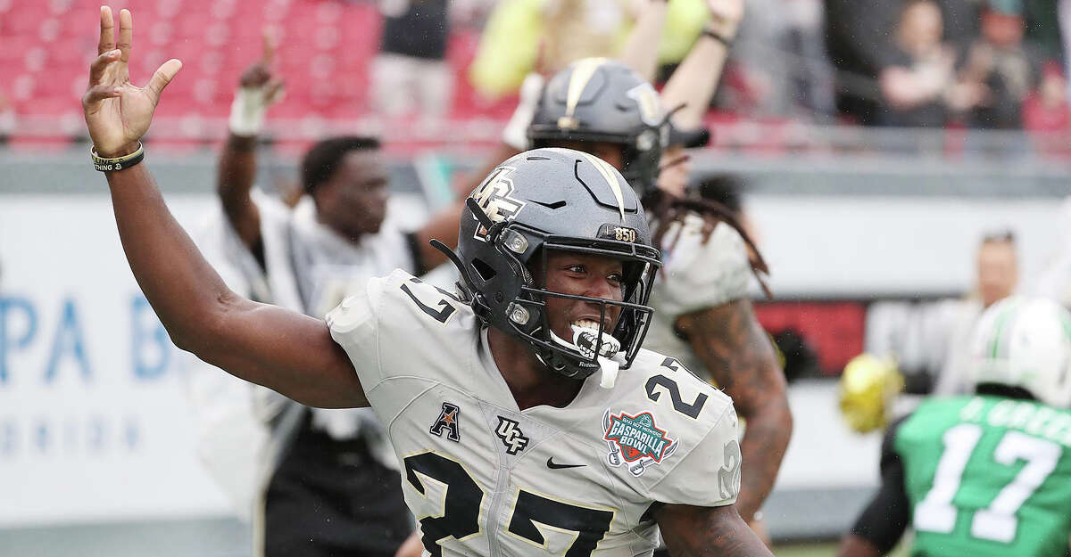 UCF defensive back Richie Grant (27) celebrates after a touchdown after an interception during the Gasparilla Bowl game of UCF versus Marshall at Raymond James Stadium in Tampa, Fla., on Monday, Dec. 23, 2019. UCF won, 48-25. (Stephen M. Dowell/Orlando Sentinel/TNS)