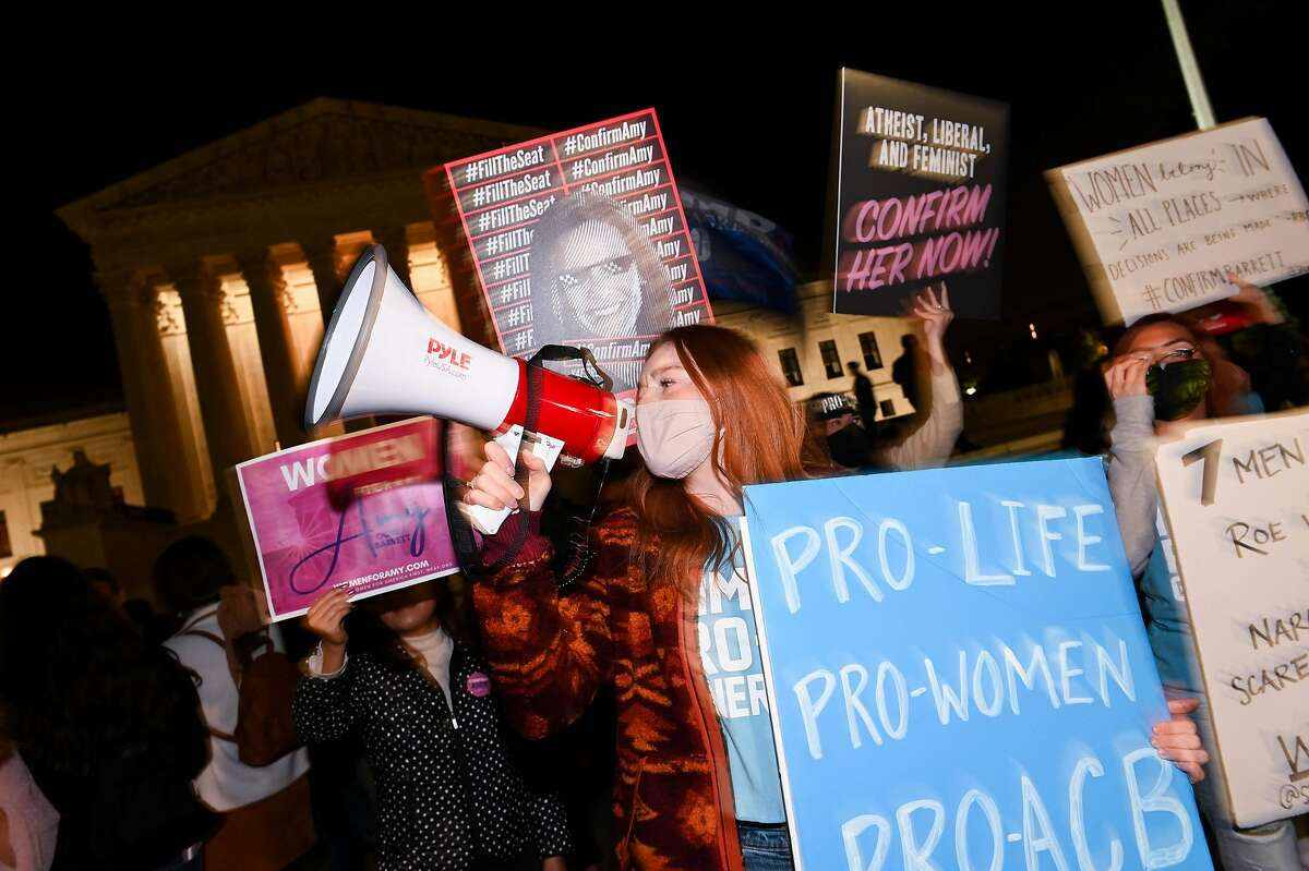 Pro Life activists and Barrett supporters celebrate outside the Supreme Court.
