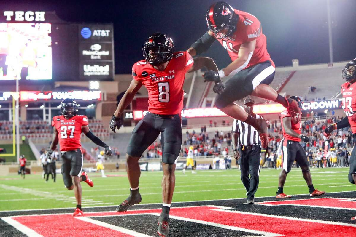 LUBBOCK, TEXAS - OCTOBER 24: Cornerback Zech McPhearson #8 of the Texas Tech Red Raiders celebrates with linebacker Jacob Morgenstern #41 after running an interception for a touchdown during the second half of the college football game against the West Virginia Mountaineers on October 24, 2020 at Jones AT&T Stadium in Lubbock, Texas. (Photo by John E. Moore III/Getty Images)