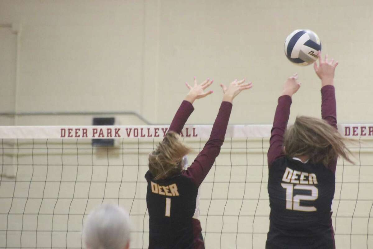 Tatum Busch (1) and Ella Gilbert form a block party during their district game with Rayburn last Friday.