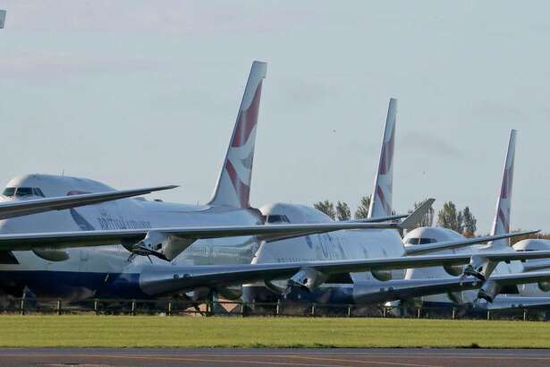British Airways jets parked in the United Kingdom's Cotsworld Airport, with the airline retiring the aircraft due to the COVID-19 pandemic that has impacted the commercial aviation industry and suppliers like East Hartford, Conn.-based Pratt & Whitney. (AP Photo/Frank Augstein)