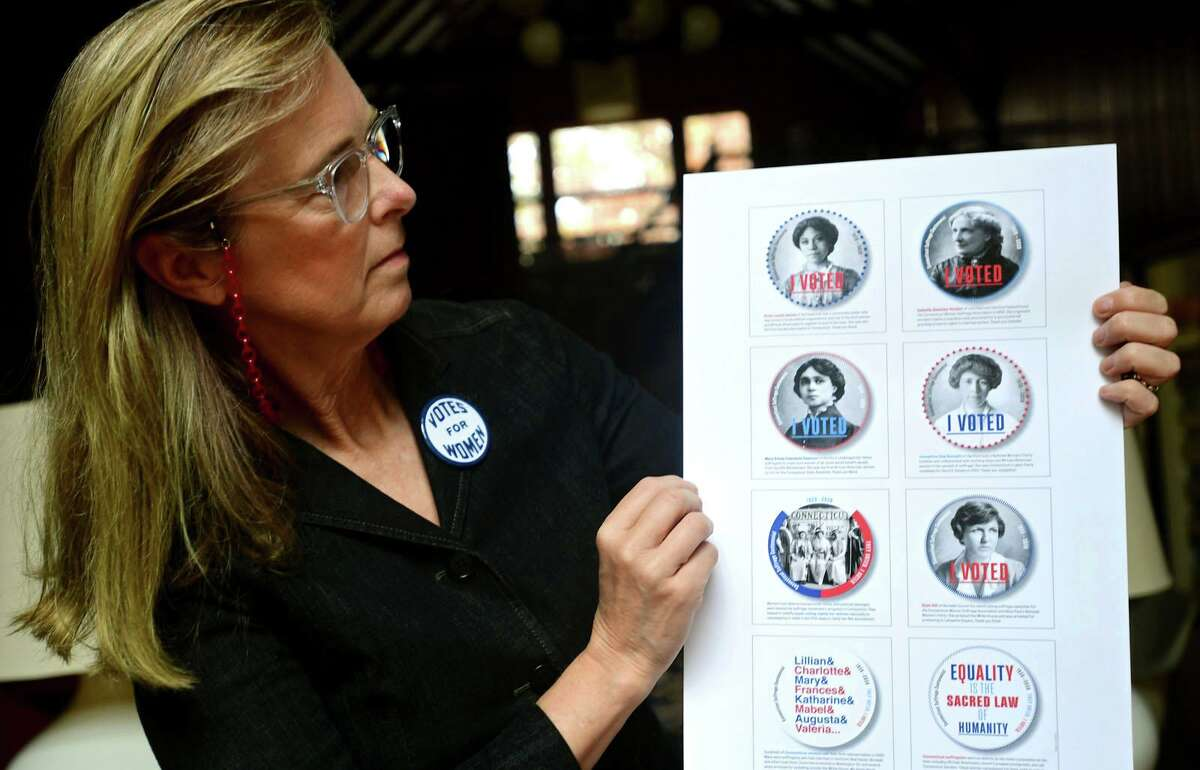 """Pamela Hovland at her home with """"I Voted"""" stickers she designed Saturday, October 24, 2020, in Wilton, Conn. Hovland has designed """"I Voted"""" stickers for the Nov. 3 election that feature women from CT who were active in the women's suffrage movement."""