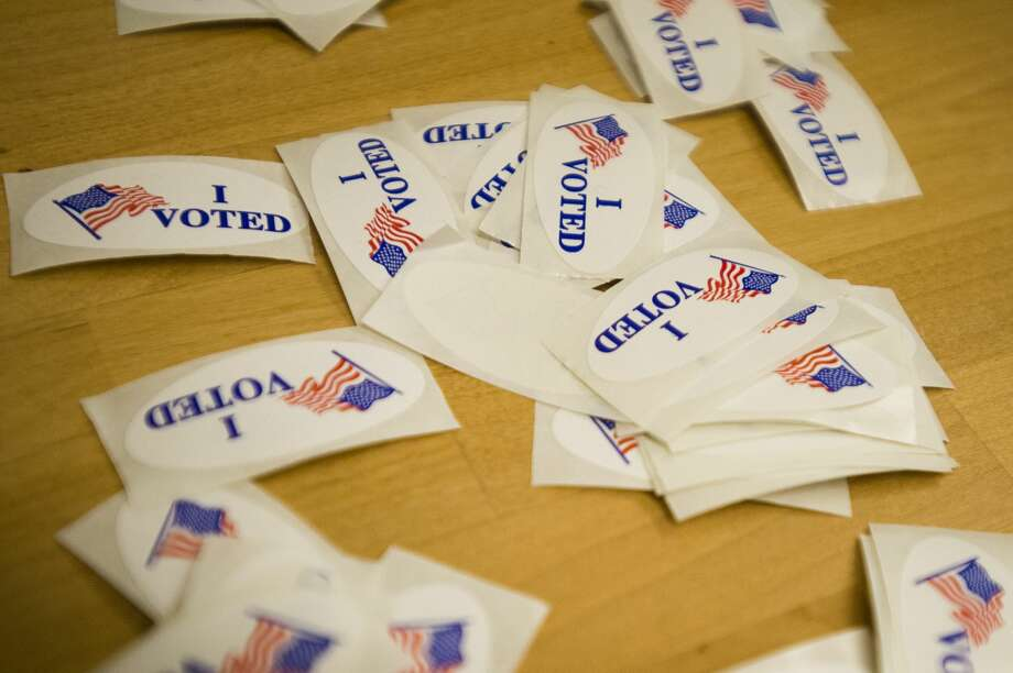 """FILE — """"I Voted"""" stickers sit on a table during the 2018 primary elections on Aug. 7, 2018 in Midland. (Katy Kildee/Hearst Michigan) Photo: (Katy Kildee/kkildee@mdn.net)"""