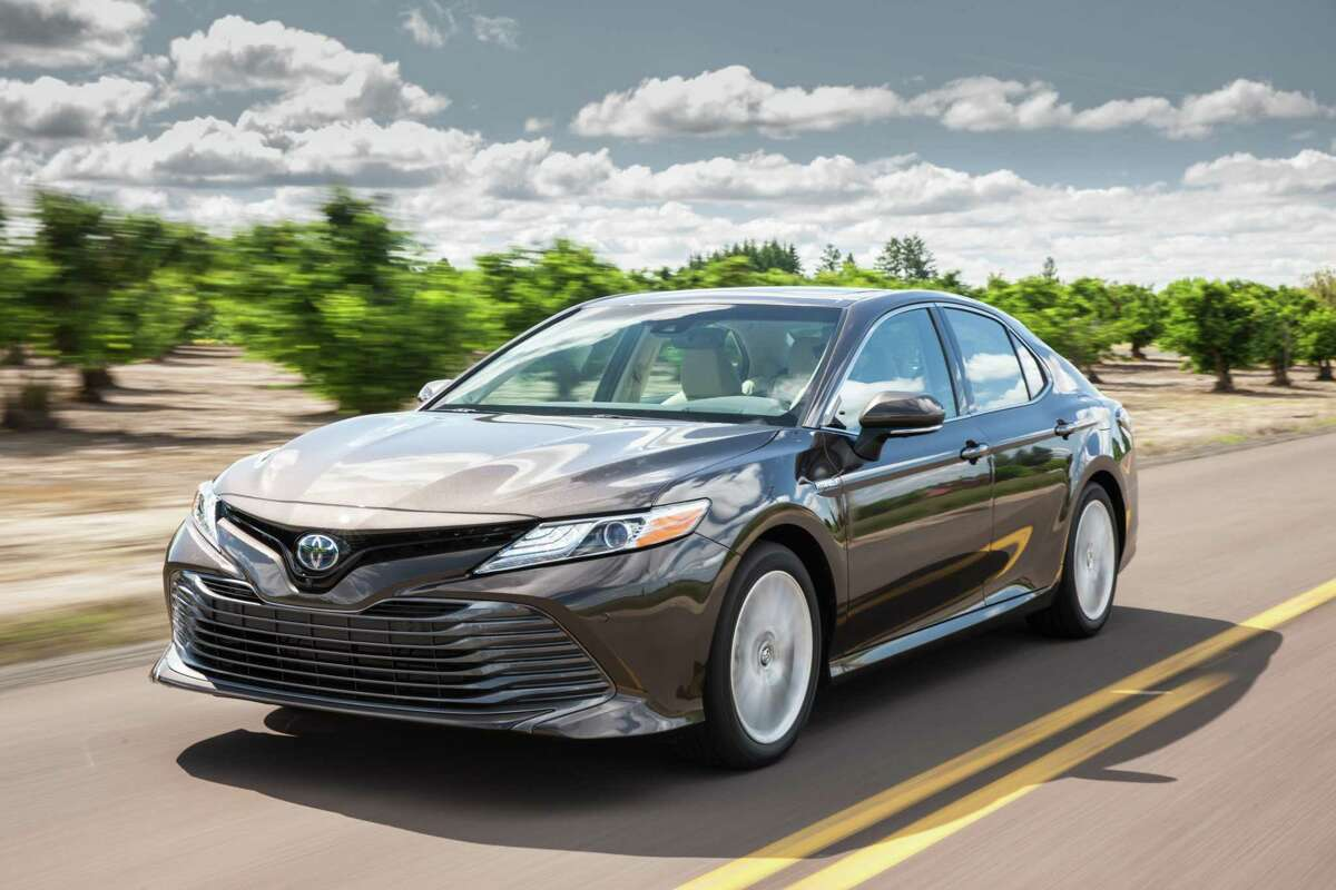 Toyota's 2020 Camry Hybrid XLE features a 2.5-liter inline Four with gasoline-electric hybrid system with 208 horsepower.