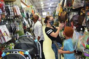The Kay family, including Damerick, left, Kayla and Kori look through costumes in preparation for the Halloween holiday. Kori selected a Harry Potter costume for his night out on the town.