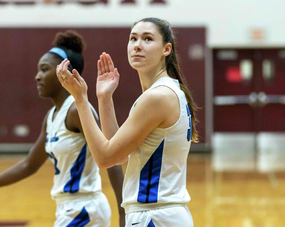 New Caney power forward Tori Garza (32) claps after scoring the basket in a Region III-5A bi-district girls basketball playoff against A&M Consolidated high school during the first half at Magnolia High School in Magnolia, Tuesday, Feb. 18, 2020. Photo: Gustavo Huerta, Houston Chronicle / Staff Photographer / Houston Chronicle © 2020