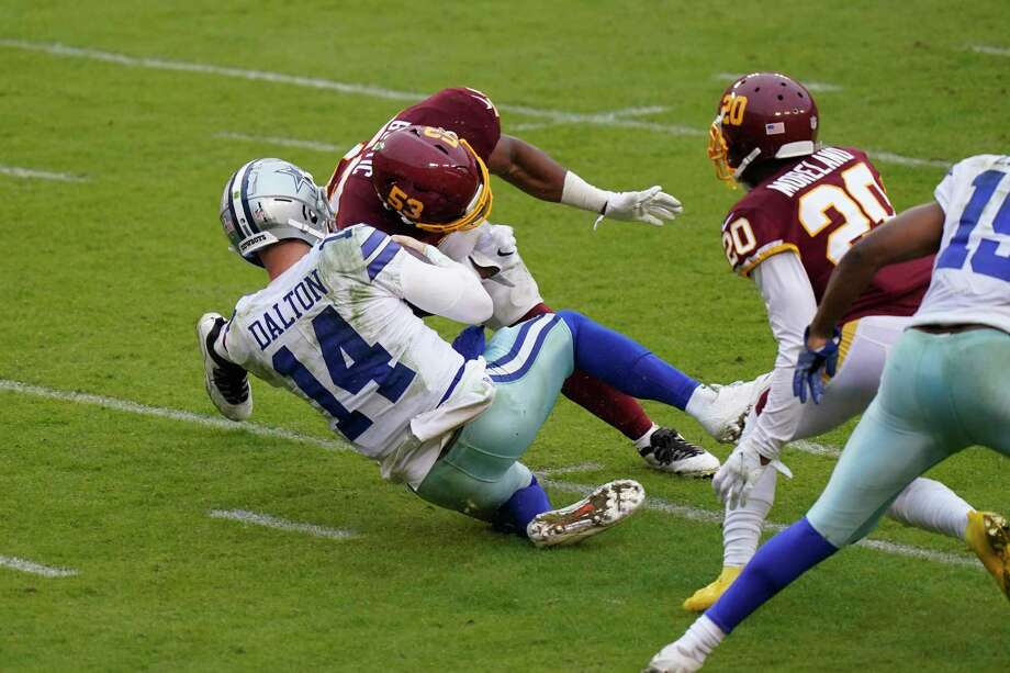 Cowboys quarterback Andy Dalton suffered a concussion on this hit by Washington linebacker Jon Bostic. Photo: Patrick Semansky /Associated Press / Copyright 2020 The Associated Press. All rights reserved.