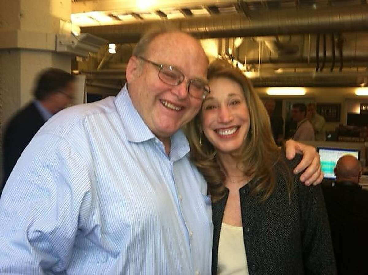 KCBS reporters Bob Melrose and Barbara Taylor smile for a photo taken in 2012.