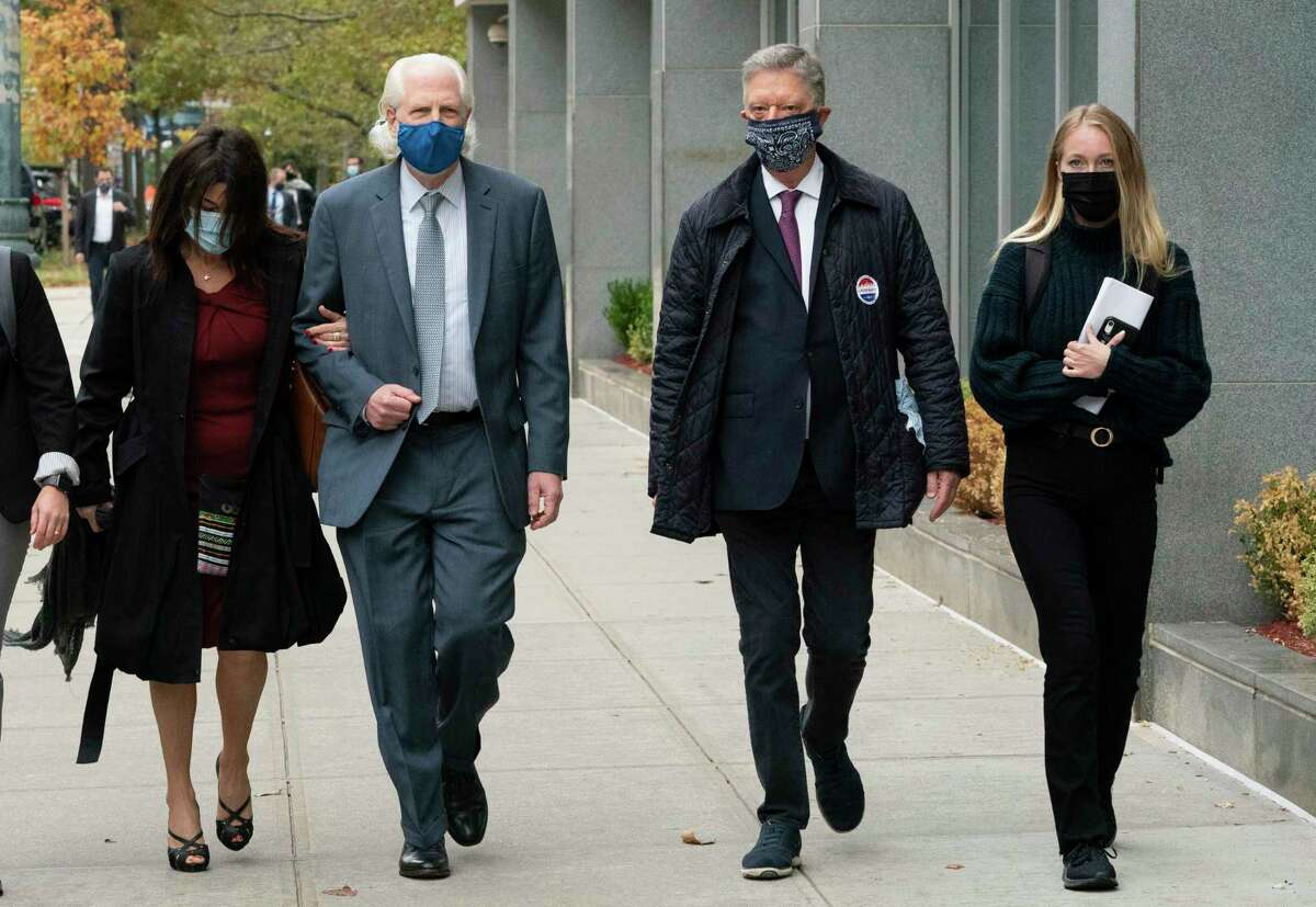 Toni Natalie, left, and India Oxenberg, right, arrive with their attorneys at Brooklyn federal court for a sentencing hearing for self-improvement guru Keith Raniere, Tuesday, Oct. 27, 2020 in New York. Raniere, whose organization NXIVM attracted millionaires and actresses among its adherents, is expected to be sentenced Tuesday on convictions that he turned some female followers into sex slaves branded with his initials.