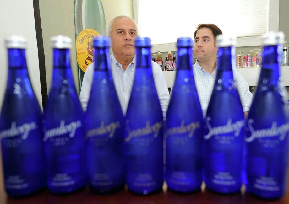 Adam Madkour(l) President and CEO and his son Adam Christopher Madkour(r) COO of Saratoga Spring Water  in Saratoga Springs speak to the media today August 31, 2010..   (Skip Dickstein/Times Union) Photo: Skip Dickstein / 2008