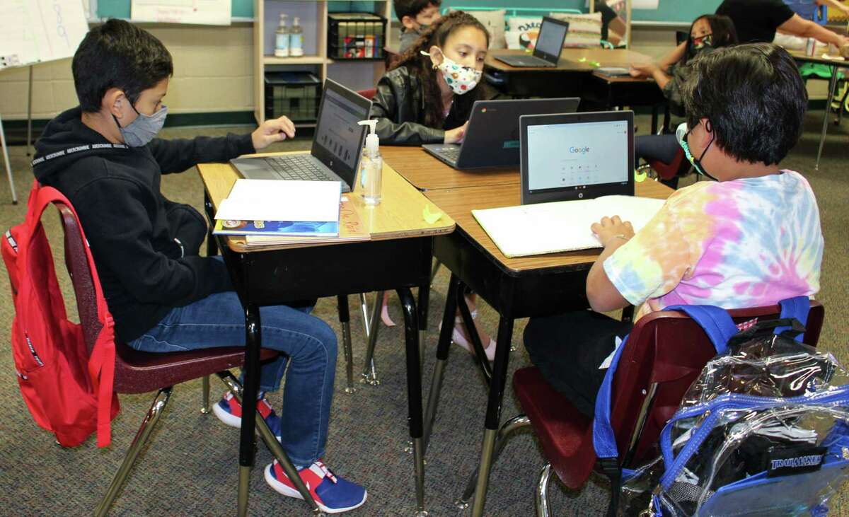 Young Elementary School Principal Amy McClennen said that 12 to 13 students a week return to campus to take in-person instruction at her school following one-on-one conversations with parents.