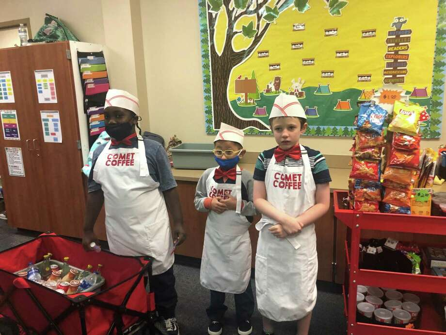 Comet Coffee, a program in the Life Skills class at Hailey Elementary in CISD, had to go through several changes this year due to the pandemic, but the customers remain dedicated. Students Baylin Holder, Eli Salazar, and Simon Waggenspack decked out in their Comet Coffee uniforms. Photo: Provided