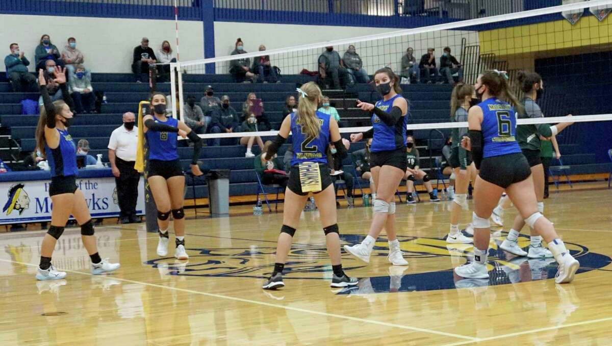 Members of the Morley Stanwood volleyball team celebrate winning a point during a home match against Hesperia on Oct. 21. (Pioneer file photo/Joe Judd)
