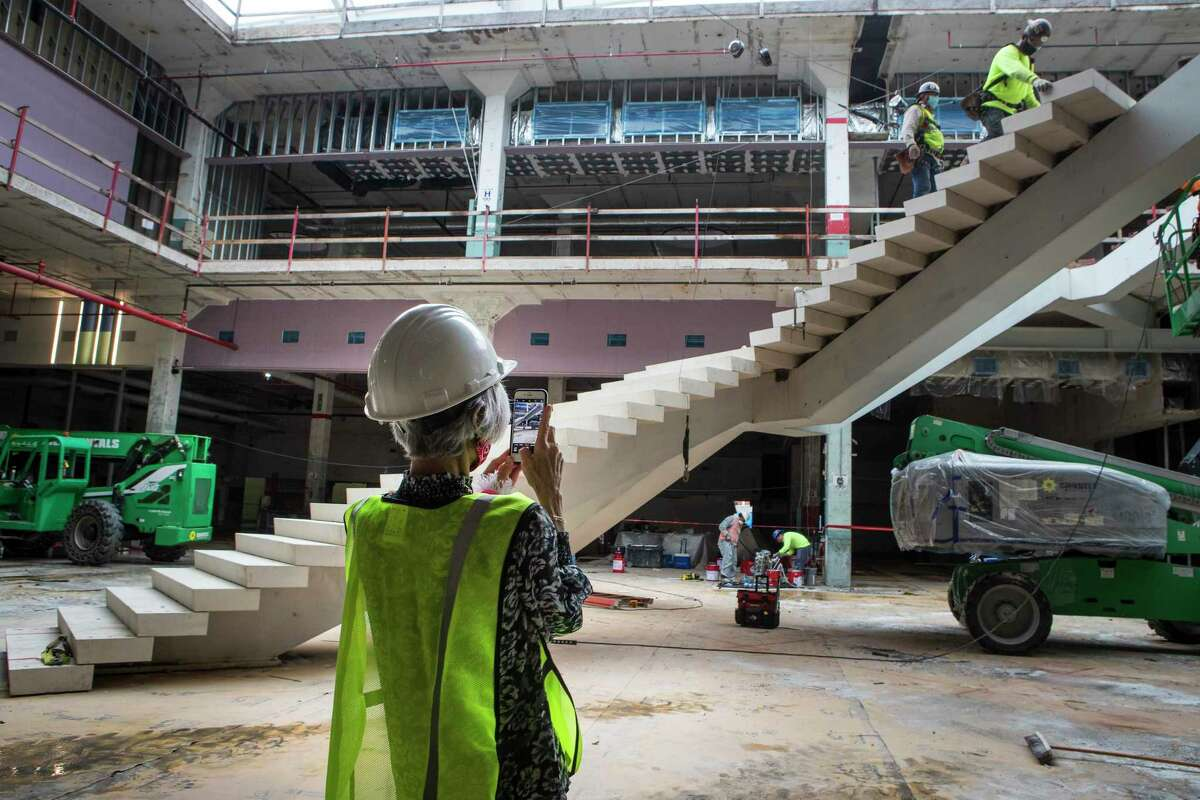 Judy Nyquist takes a photo of one of the staircases under construction at POST Houston, the downtown redevelopment of the former Barbara Jordan Post office Thursday, Sept. 24, 2020 in Houston. The historic former Barbara Jordan Post Office is being redeveloped to include a six-acre rooftop farm and park with panoramic skyline views of Houston. Lovett Commercial is developing the space, calling it POST Houston with plans to include experimental shopping options, an international food hall, co-working offices, and a music venue.
