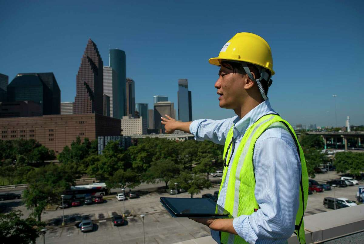 Kirby Liu leads a tour of the Barbara Jordan Post Office in downtown Houston, Thursday, June 13, 2019. Liu is leading Lovett Commercial's redevelopment of the former post office that was in use from 1936 to 2014 at 401 Franklin Street on the northwest side of downtown. The project, called Post Houston, will house more than 550,000 square feet of entertainment, retail and office space, as well as plans for one of the world's largest rooftop parks and farms.