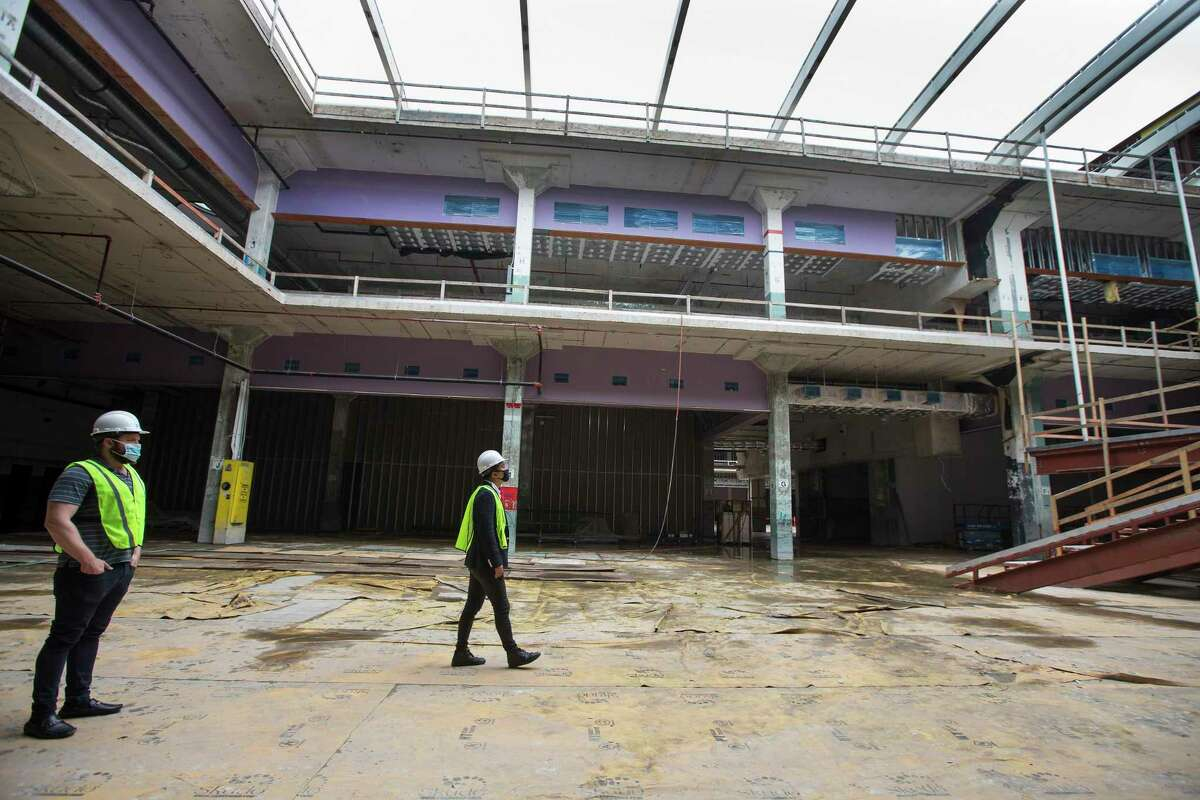 Derrick Diotalei, left, and Kirby Liu, of Lovett Commercial, tour at POST Houston, the downtown redevelopment of the former Barbara Jordan Post office Thursday, Sept. 24, 2020 in Houston. The historic former Barbara Jordan Post Office is being redeveloped to include a six-acre rooftop farm and park with panoramic skyline views of Houston. Lovett Commercial is developing the space, calling it POST Houston with plans to include experimental shopping options, an international food hall, co-working offices, and a music venue.