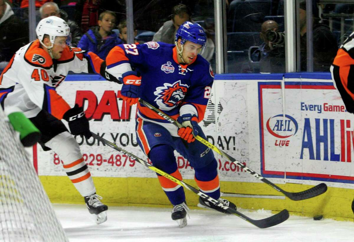 Sound Tigers' Parker Wotherspoon and Lehigh Valley's James de Haas, left, converge on the puck during AHL hockey action at the Webster Bank Arena in Bridgeport, Conn. on Saturday Mar. 10, 2018.