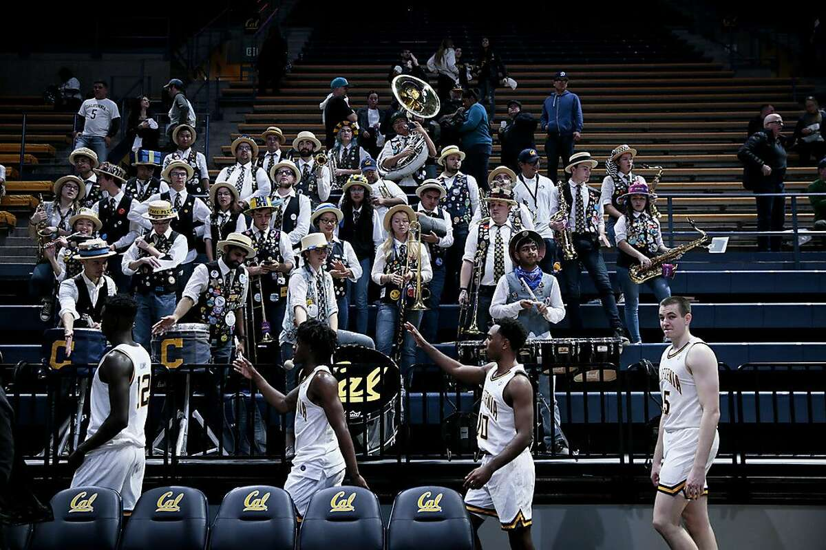 Cal basketball players acknowledge the Cal band as they walk to the locker room following their loss to Saint Mary at Haas Pavilion in December.