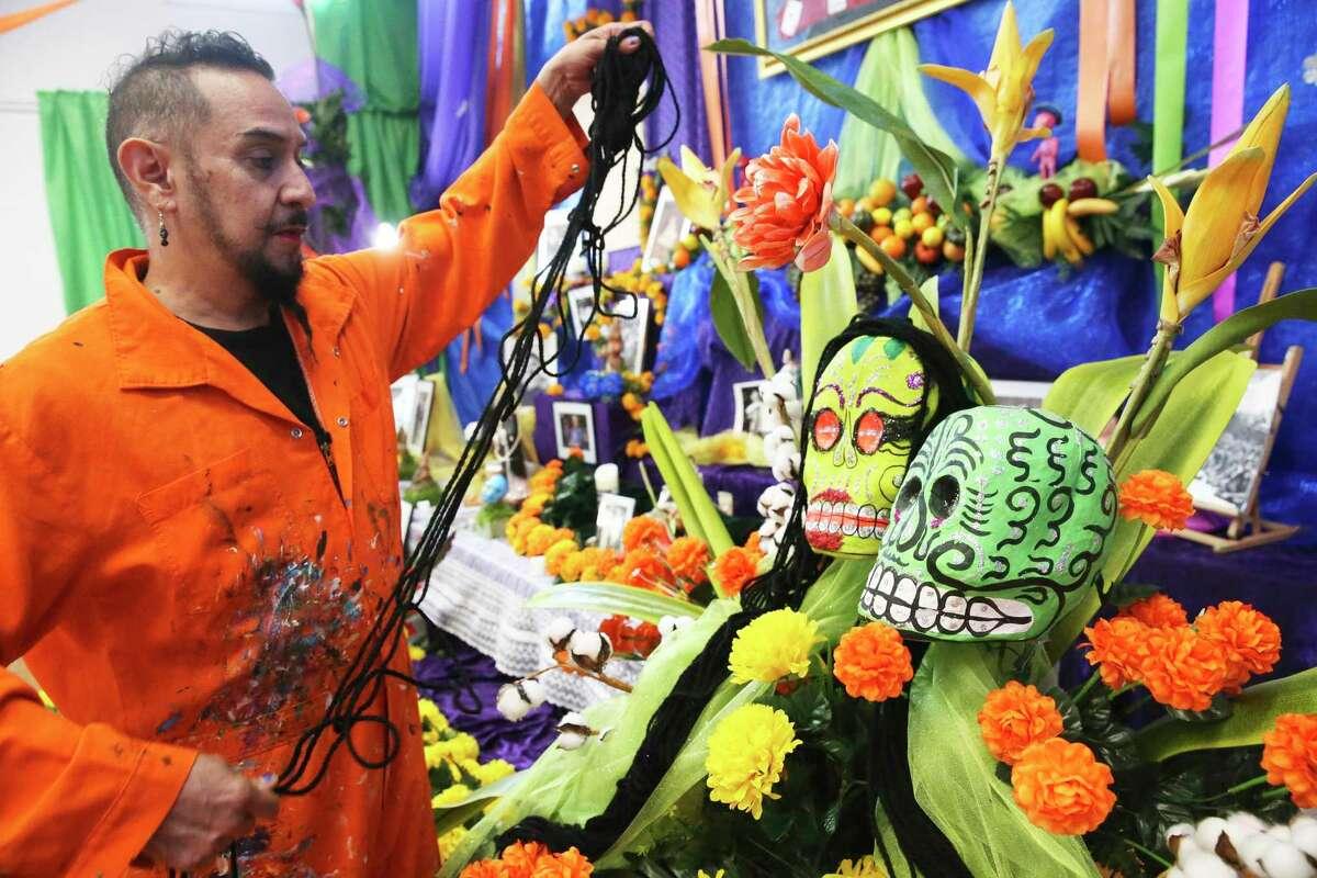 David Zamora Casas works on his Día del los Muertos altar, which is part of an installation at Bihl Haus Arts.