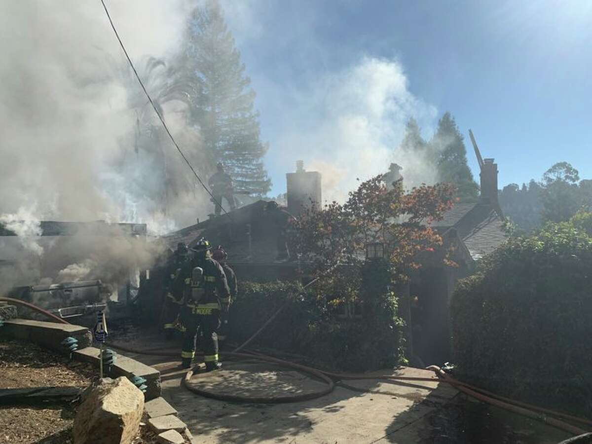 The Oakland Fire Department responded to a two-alarm fire involving two structures at Merriewood Drive and Crown Avenue on Oct. 27, 2020.