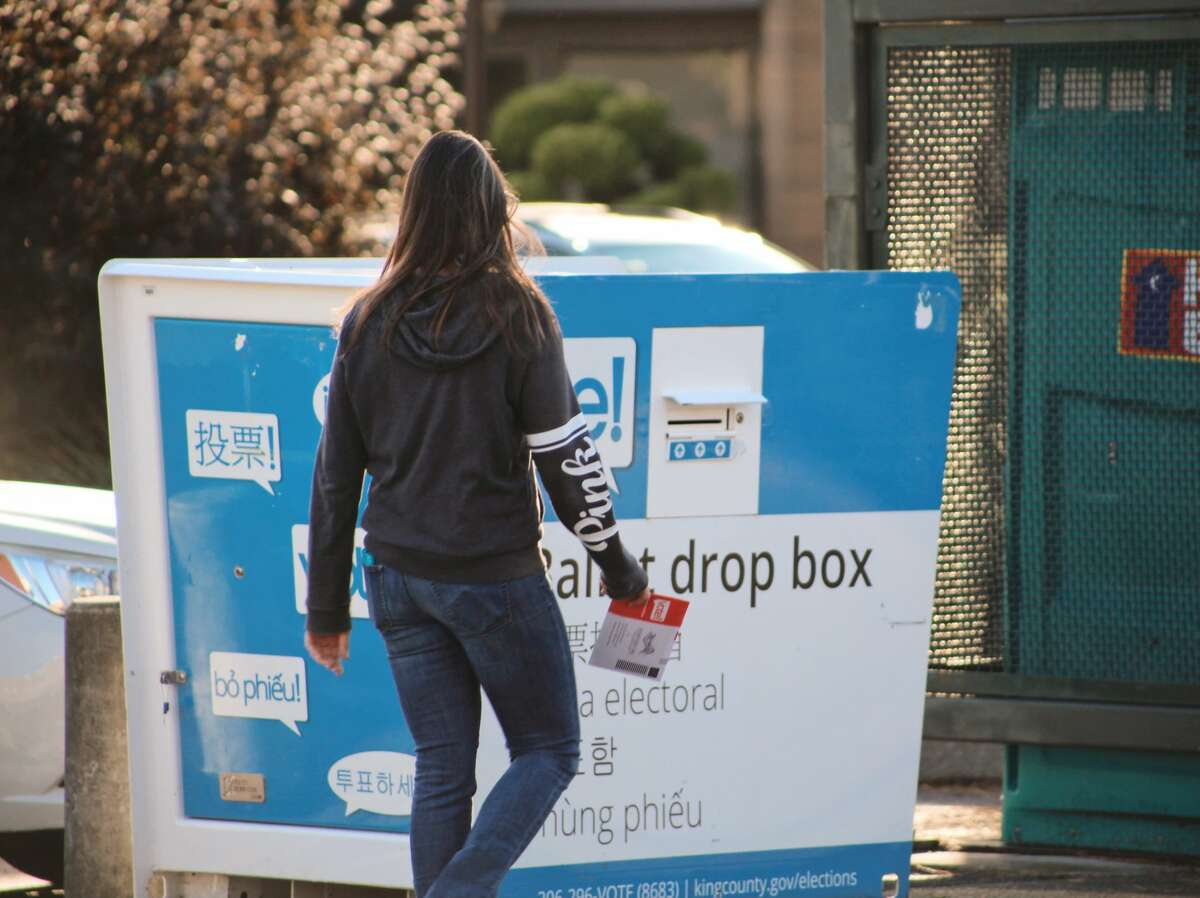 Washington voters drop off their ballots in Seattle, Washington prior to the Nov. 3 election.