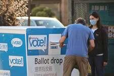 Washington voters drop off their ballots in Seattle, Washington prior to the Nov. 3 election.