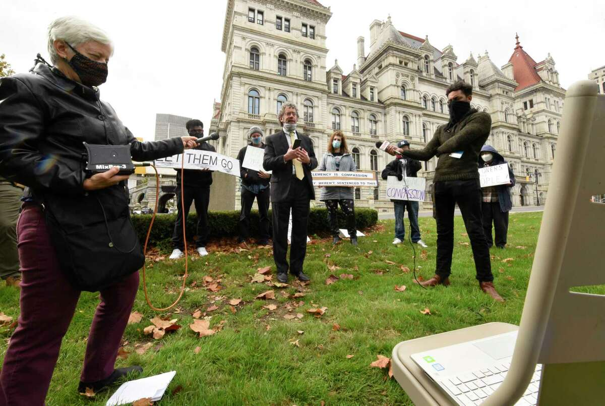Attorney Mark Mishler speaks during a protest outside the New York State Capitol about state prison conditions on Tuesday, Oct. 27, 2020 in Albany, N.Y. The event was part of a zoom meeting type protest with others around the state. There was a chair set up with a computer on it showing the zoom meeting. (Lori Van Buren/Times Union)