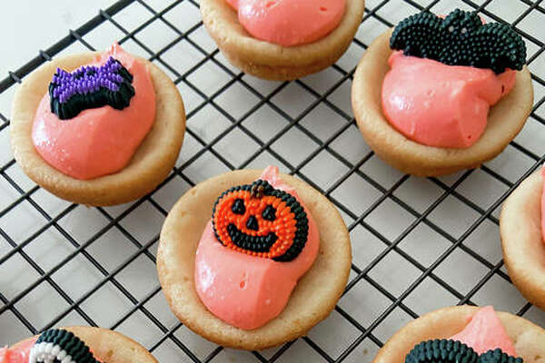 Sweet sugar cookie cups are decorated with edible Halloween goodies.