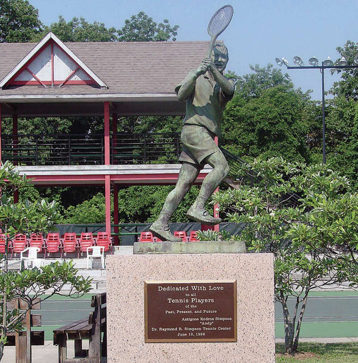 """A statue of the late Dr. Raymond """"Bud' Simpson stands at the tennis center that bears his name in Gordon Moore Park."""