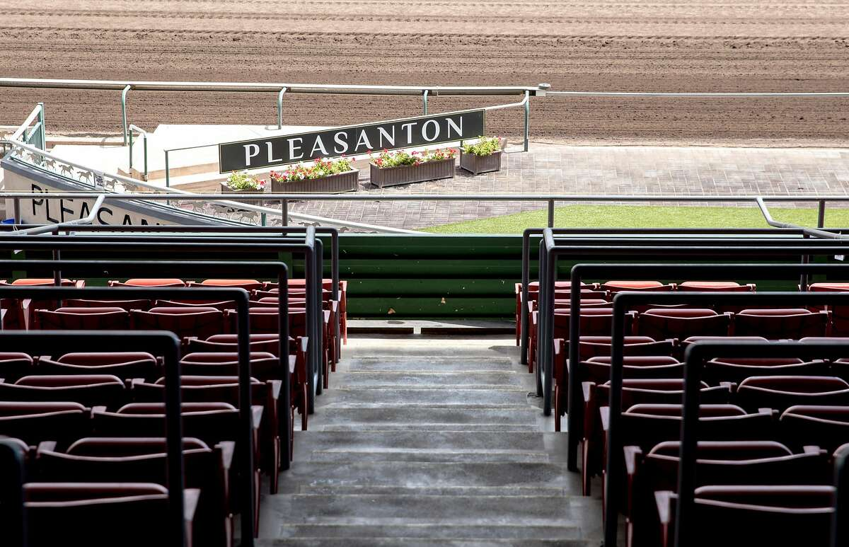 Grandstand seats sit empty ahead of the horse races held at the Alameda County Fairgrounds in Pleasanton, Calif. Thursday, June 27, 2019.