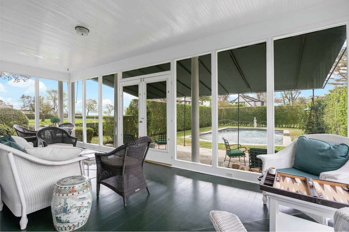 The sizable screened porch has views of the pool and Long Island Sound.