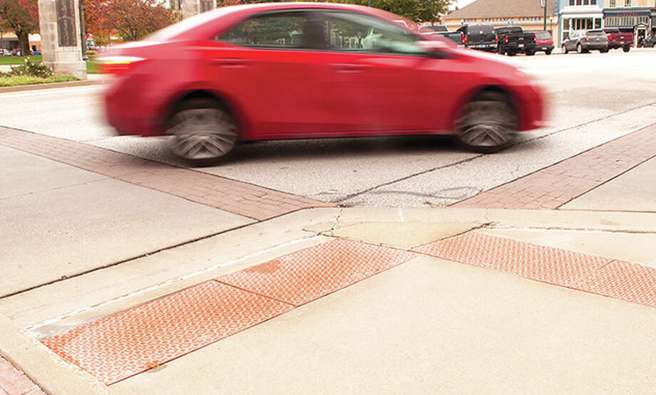 The city will be replacing deteriorated pads that warn people they are approaching a road. Photo: Darren Iozia   Journal-Courier / Jacksonville Journal-Courier