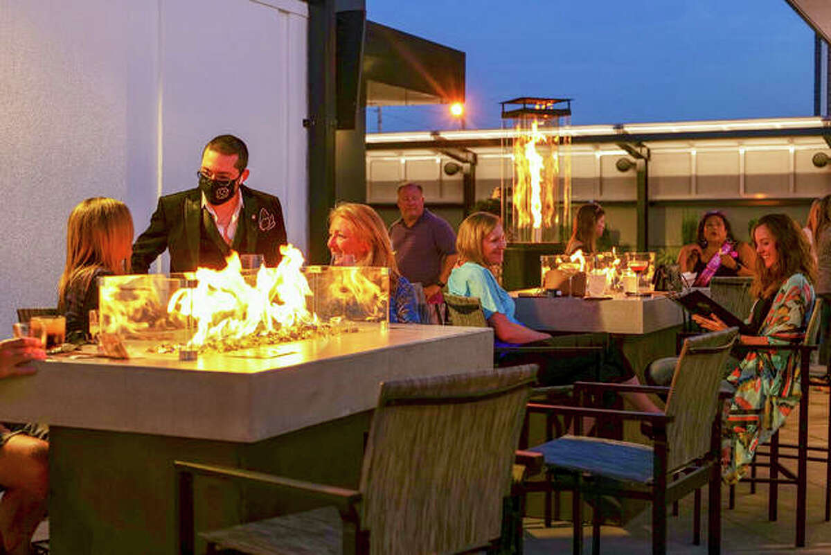 EXO Lounge's Tolia Jarke, head concierge, greets patrons on the new all-seasons plush patio at EXO, No. 2 157 Center, Edwardsville.