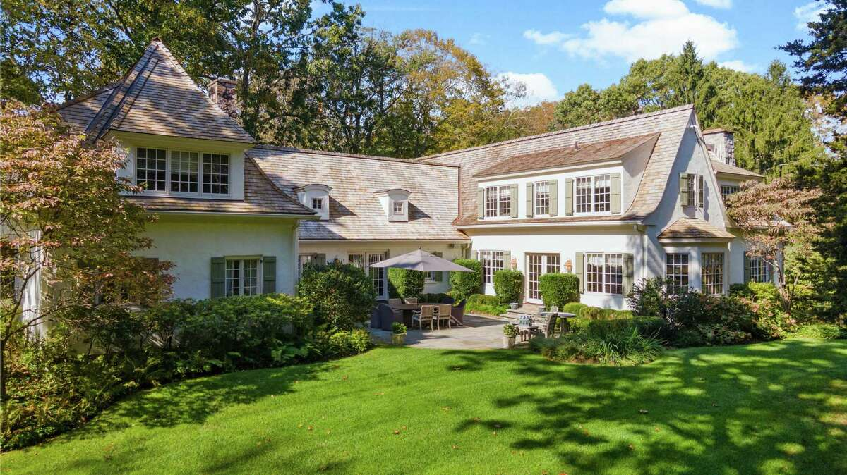 The French Chateau-style house at 9 Graenest Ridge Road in Wilton sits on a private property of more than four acres, yet walking distance to Wilton Center and the train station.