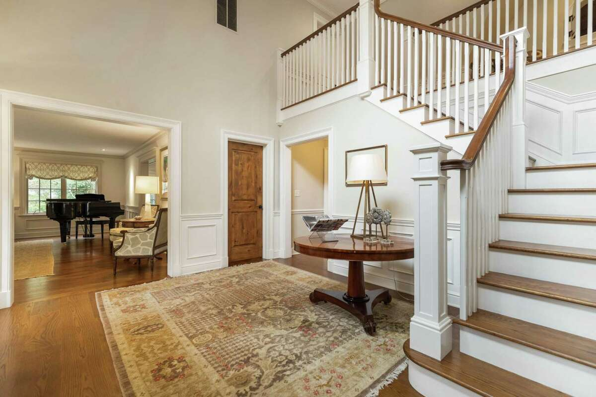 The house has an open floor plan beginning in the two-story foyer.