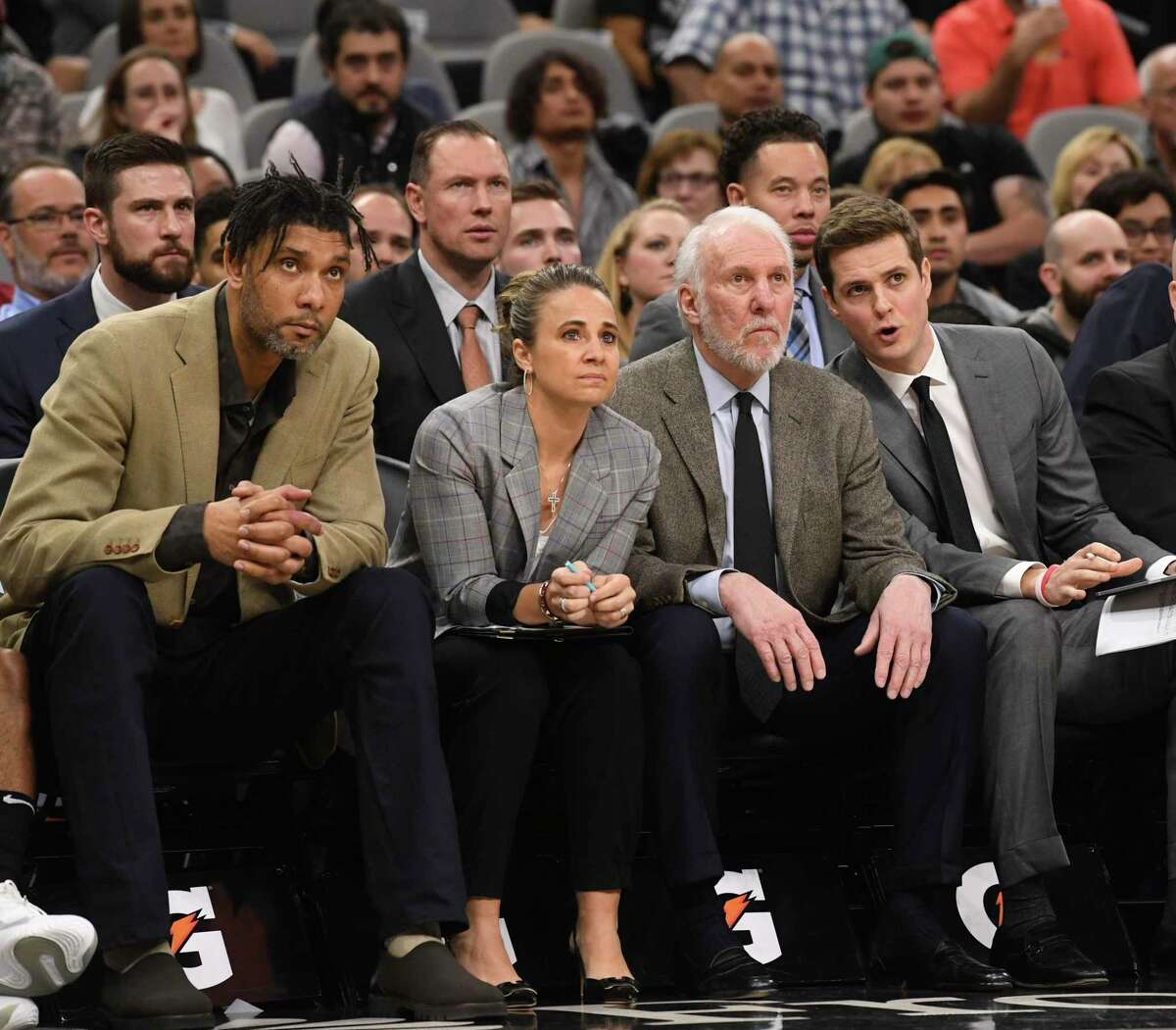 Becky Hammon was the first female assistant coach in the NBA to gain 'front row' status. Here she is framed by assistant coach Tim Duncan, left, San Antonio Spurs head coach Gregg Popovich, second from right, and assistant Will Hardy in a game against the Pacers in March.