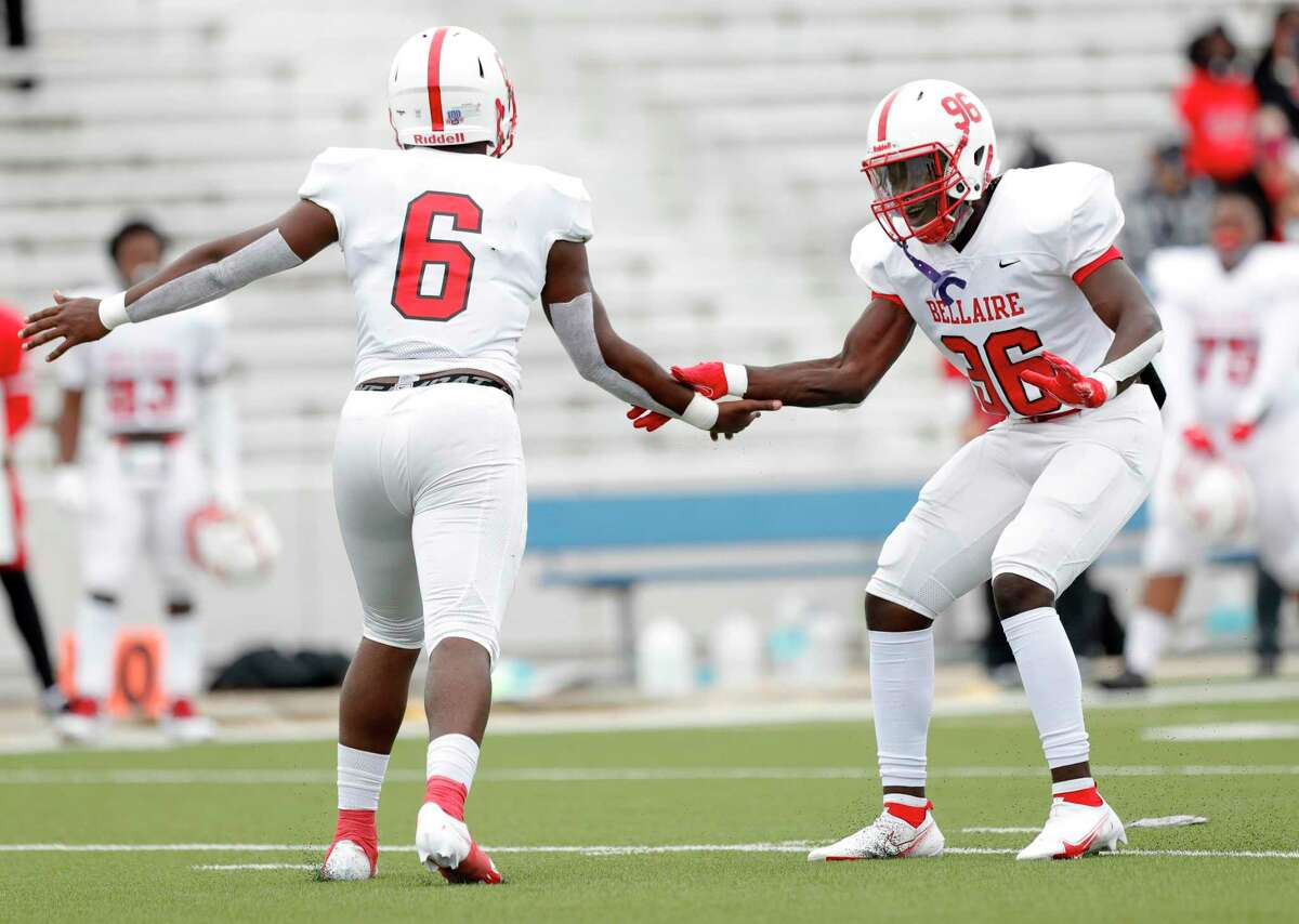 Bellaire defensive end Keelon Smith (96) celebrates after linebacker Rodney Dansby (6) broke up a pass on fourth down during the first quarter of a District 18-6A high school football game at Delmar Stadium, Saturday, Oct. 24, 2020, in Houston.