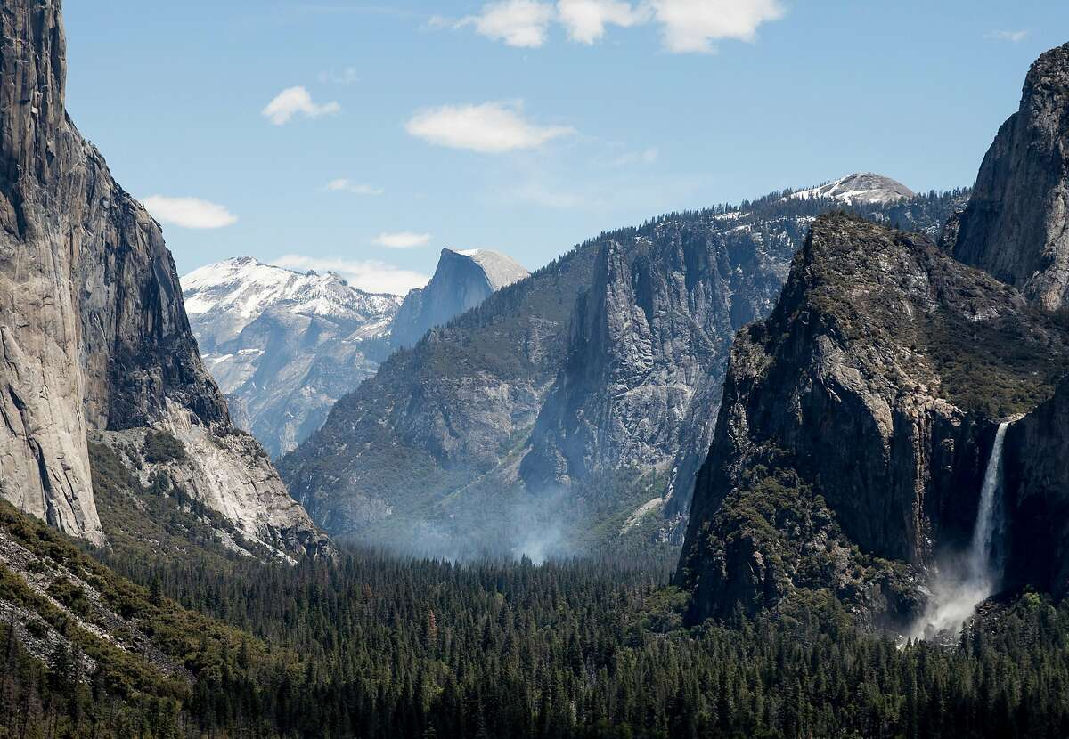 Smoke rises from Yosemite Valley as officials perform a controlled burn inside Yosemite National Park in Yosemite, Calif. Tuesday, May 28, 2019.