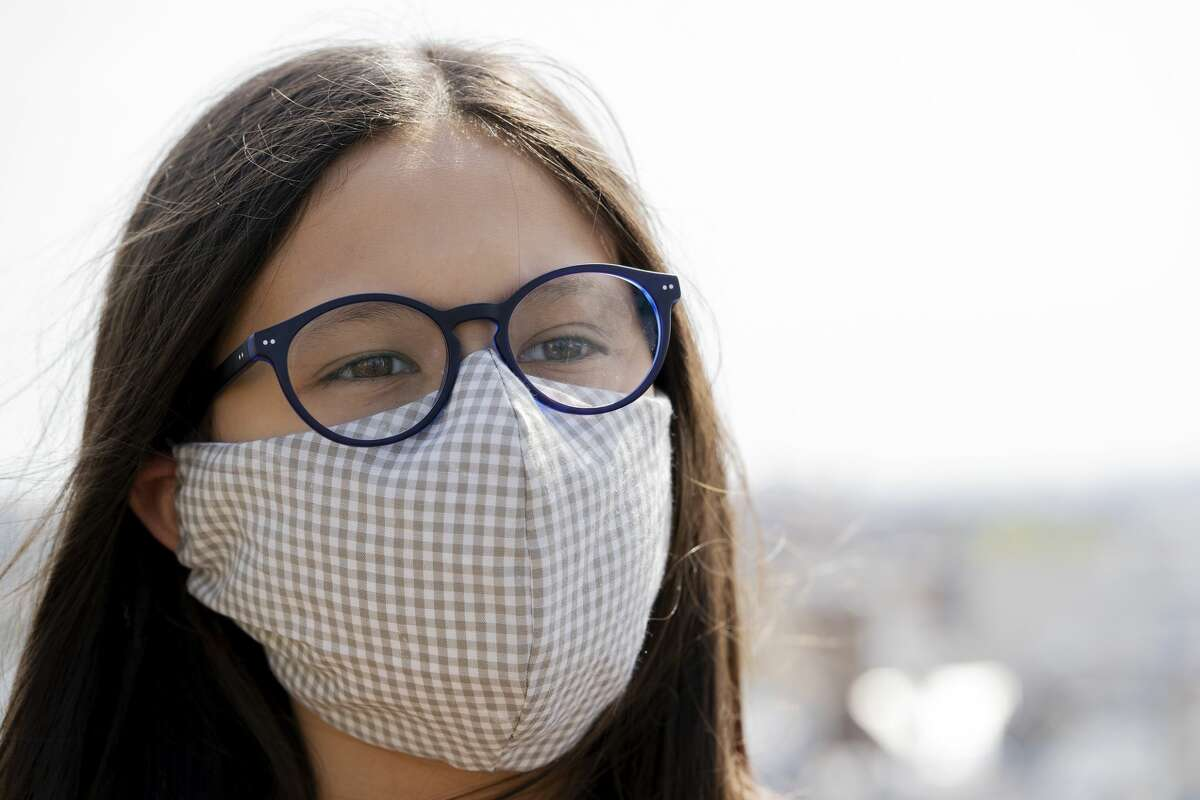 Portrait of teenage girl wearing a homemade face mask to protect her health from coronavirus.