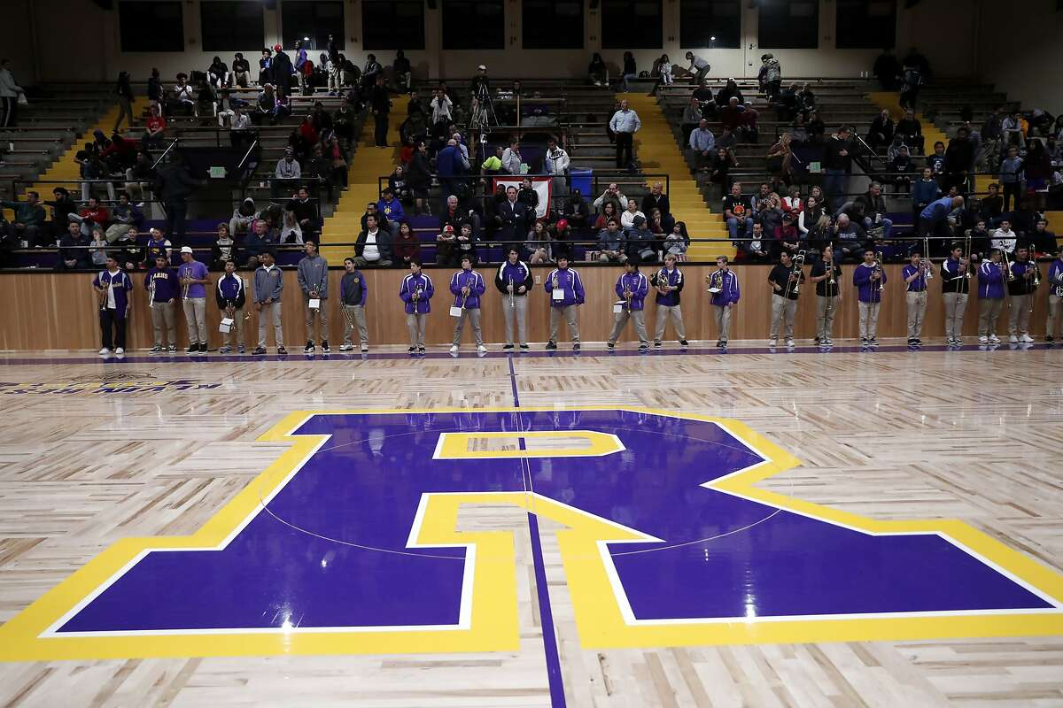 The Archbishop Riordan High School band readies to play before a basketball game. Riordan has been cleared for in-person learning.