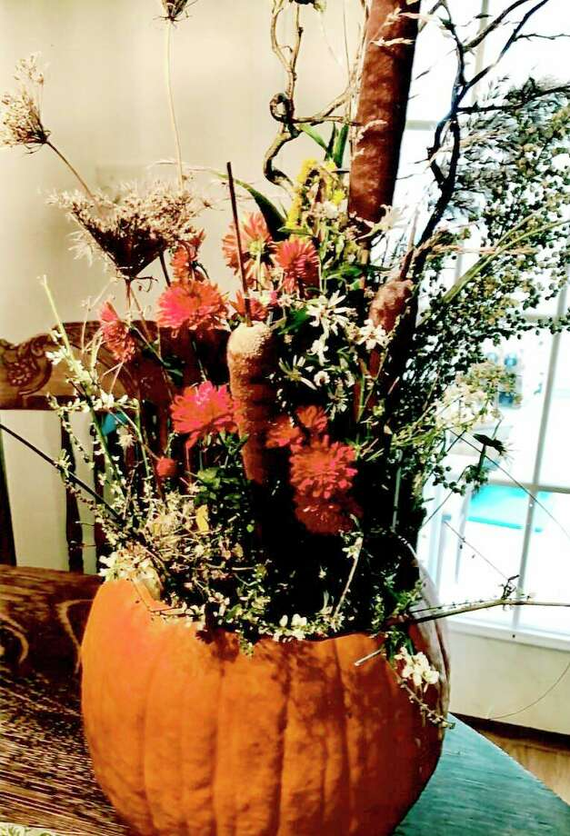 Table decorations were auctioned off at the Spirit of the Woods Garden Club Inc. annual fundraiser this month. (Courtesy photo)