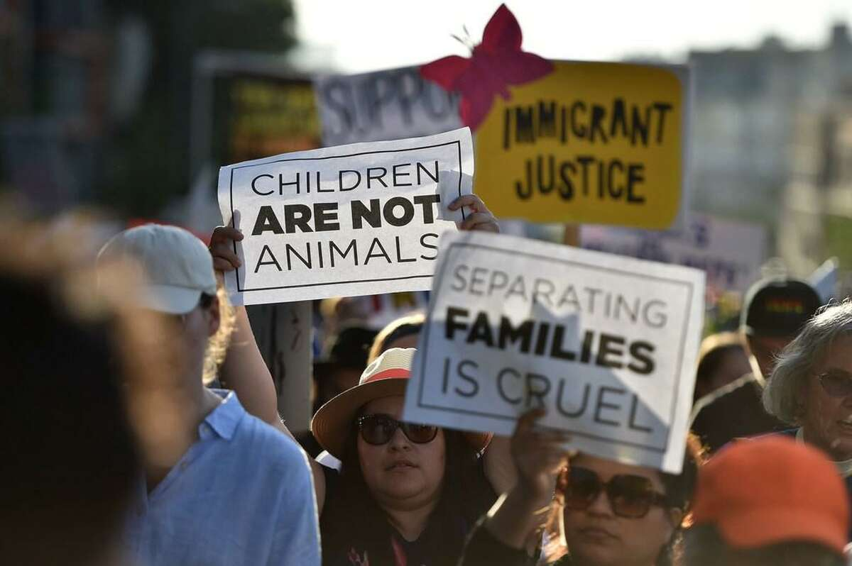 In this file photo taken on June 14, 2018 Critics of US government policy which separates children their parents when they cross the border illegally from Mexico protest during a 'Families Belong Together March', in downtown Los Angeles, California . Nearly 2,000 minors were separated from their parents or adult guardians who illegally crossed into the United States over a recent six-week period, officials said Friday in the most comprehensive 2018 figures provided on family separations.