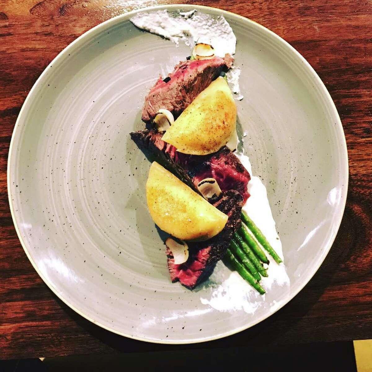 Hanger steak with potato and cheddar pierogi, green beans and horseradish cream at Riel restaurant.