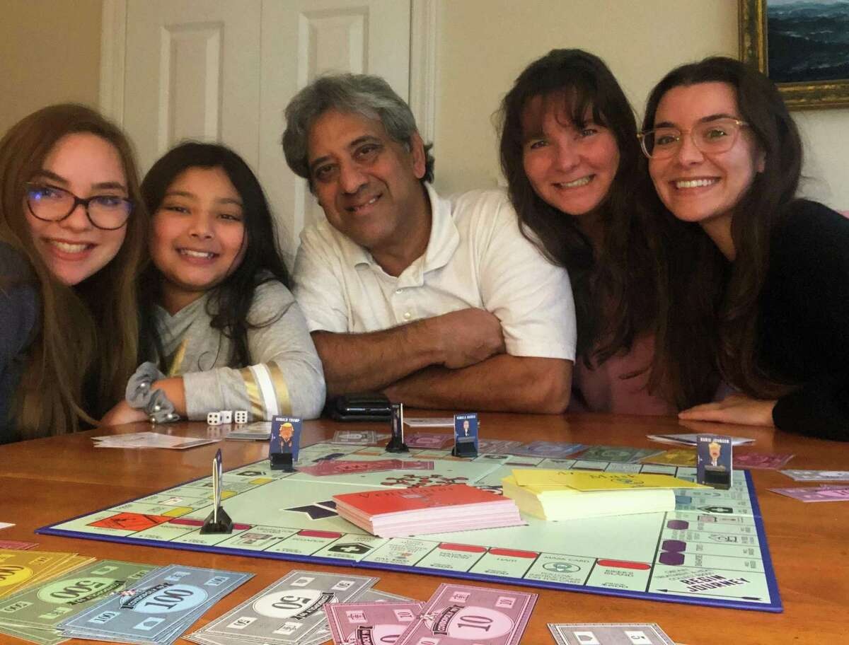 Shahan Islam plays his new Covidopoly19 game with family members, Kari, Elizabeth, wife Teryl, and Elyssa.