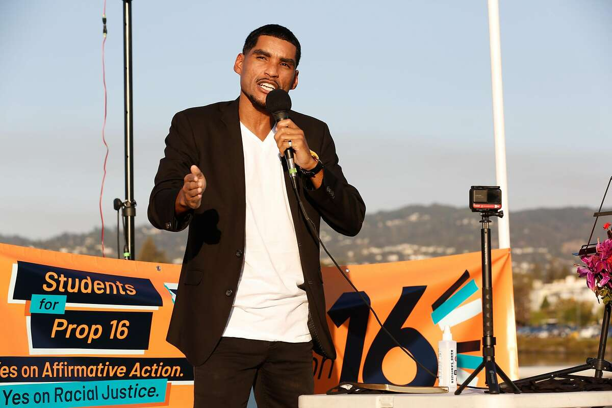 Jovan Agee, former deputy treasurer of California and founder of Savvy Consulting, speaks in support of removing the ban on affirmative action at a Yes on Prop 16 rally at Lake Merritt on Friday, October 16, 2020 in Oakland, Calif.