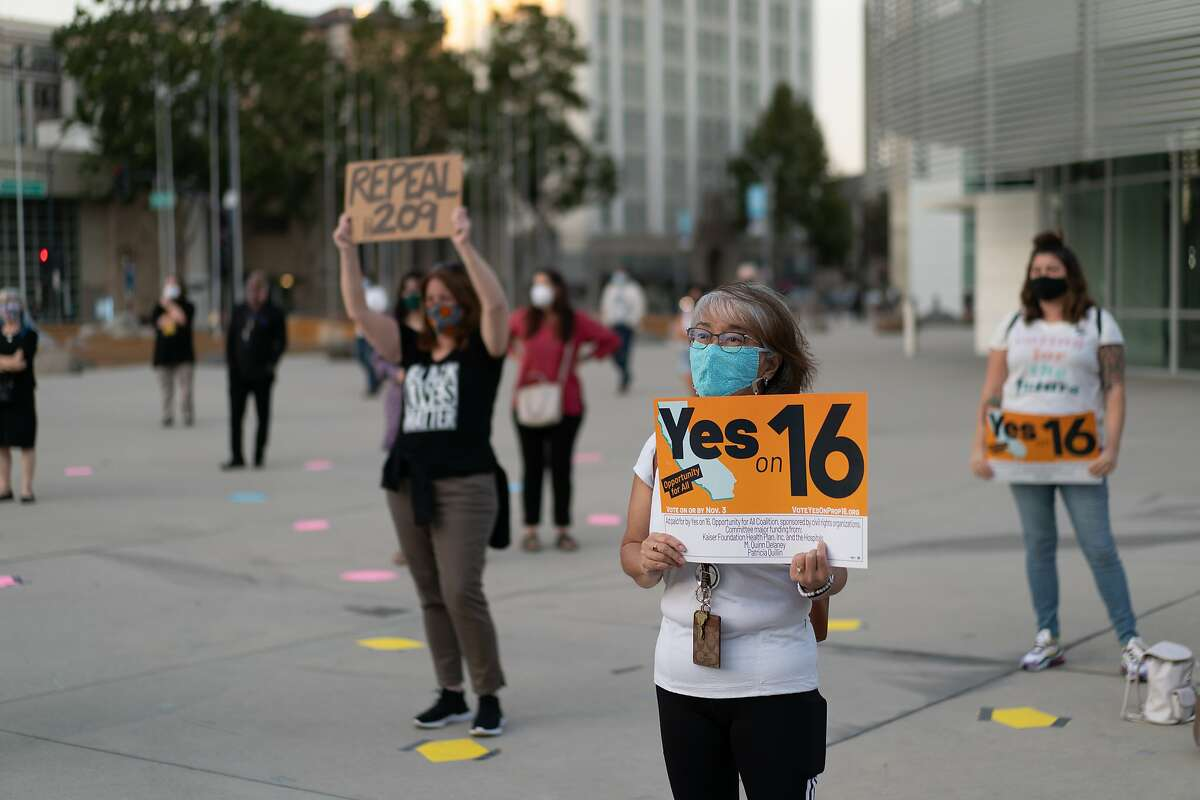 Naomi Nakano-Matsumoto attends a rally at the San Jose City Hall to support proposition 16, which would repeal the state's ban on affirmative action on Saturday, Sept. 26, 2020 in San Jose, Calif.